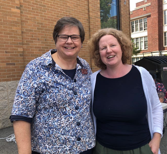 Kathy Schneider celebrates her retirement with Katie Elliot. Schneider retired recently from St. Margaret's House. Elliot is replacing her as executive director.