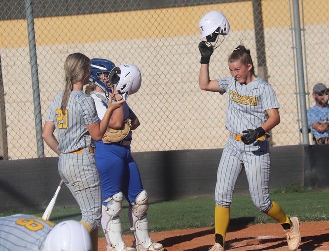 Tecumseh's Emily Bingham (right) is greeted at home plate by teammate Katelyn Fleming after Bingham hit the first of her two home runs Tuesday against Mount St. Mary.