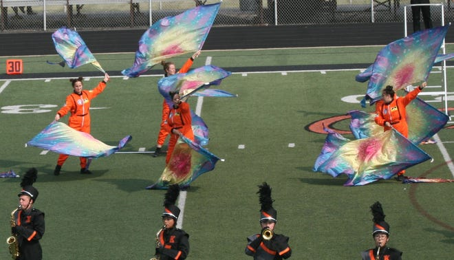 The KHS Marching Band's flag corps supplies some extra flair during a recent competition in Washington.