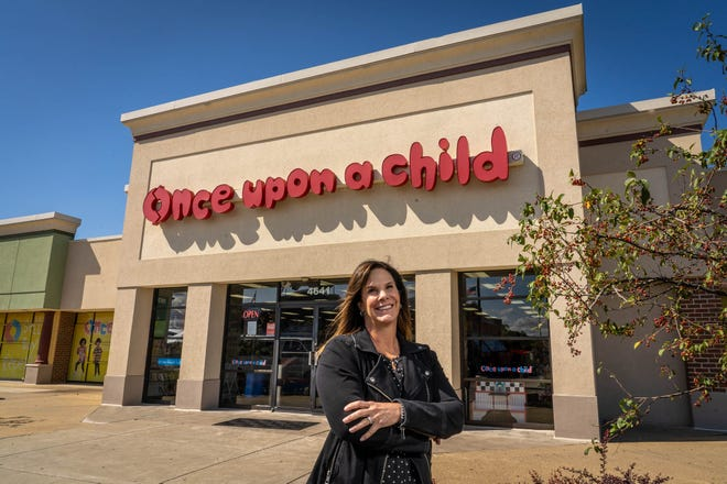 Current owner and President of the Minney Group, Barb Minney-Schweier in front of the Once Upon a Child store in Jackson Township.