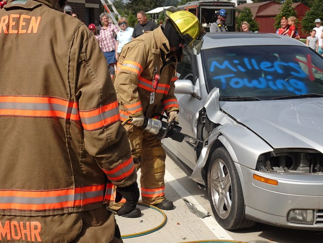 Green firefighters give a demonstration on using the jaws of life to free people from trapped vehicles during an open house on Sept. 18.