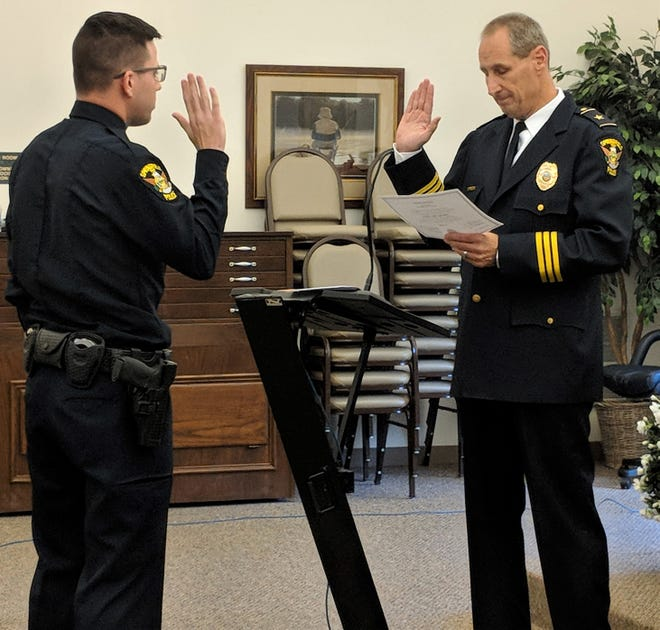 Springfield Police Chief Jack Simone swears in Noah Wardle as a full-time police officer.