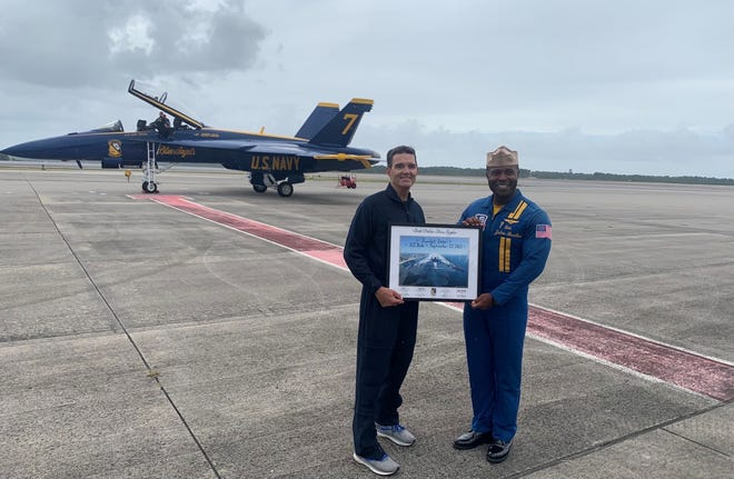 Lt. Julius Bratton, Blue Angels #7 pilot, and Randall Siler, Blue Angels Key Influencer pictured after almost hour long plane ride at Marine Corps Air Station Cherry Point on Sept. 22.