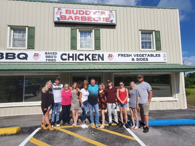 """Hoyte """"Buddy"""" Brannon is pictured with family, employees and friends at his new restaurant in Ernul."""