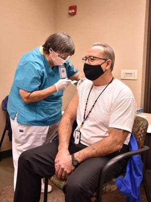 Prairie Band Potawatomi Nation Chairman Joseph Rupnick receives the first dose of the COVID-19 vaccine at the Prairie Band Health Center in December 2020.