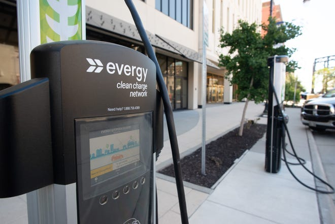 Evergy electric chargers await vehicles Tuesday afternoon in front of the Evergy building downtown off S. Kansas Ave. and 8th Street.