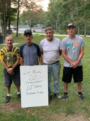 The 2nd Annual DJ Show Memorial Horseshoe Tournament was held Sept. 18 at Kingwood Grove. The top four pitchers tied for first place. They are Terry Smith, Raymond Rugg, Domer Leighty and Bobbie Faidley. There were a total of 16 pitchers. DJ Show was killed in a snowmobile accident several years ago out west.