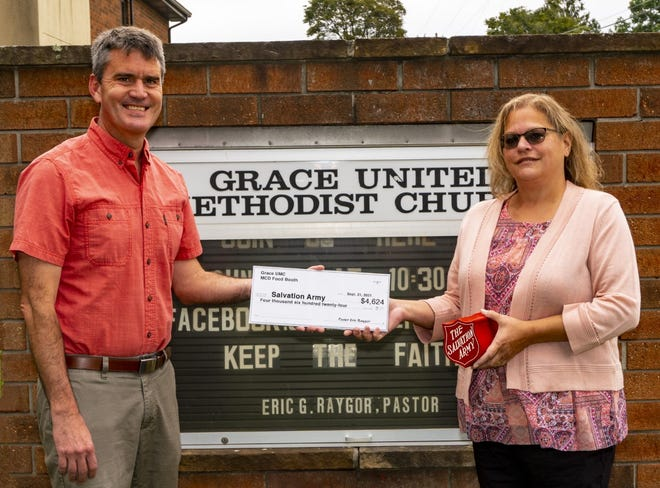 The Rev. Eric Raygor (left), pastor of Grace United Methodist Church, 320 Felgar Road, Somerset, presented a check for $4,624 to Gale Purbaugh, Salvation Army Somerset Service Center director. The check represents the profits from the church's food booth at the recent Mountain Craft Days festival held at the Somerset Historical Center.