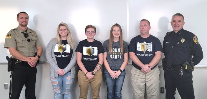 Codington County Sheriff Department Chief Deputy Brent Solum, far left, and Watertown Police Chief Tim Toomy, far right, answered questions of Mount Marty University students Cassie Swedeen, Alycia Kortan, Ashley Hohn and George Jibbons. The students expressed an interest in joining the police force after graduation.