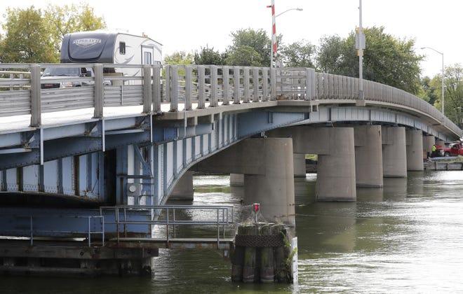 Traffic crosses over the Racine Street bridge in Menasha. The bridge will be closed Monday for the start of demolition.