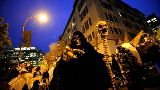 Thousands of New Yorkers descend onto the streets to take part in the annual Halloween parade in Greenwich village, New York on Oct. 31, 2011.