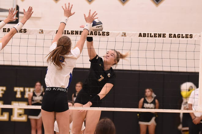 Abilene High's Gentri Anderson (7) spikes the ball during Tuesday's District 2-6A match against Wolfforth Frenship at Eagle Gym on Sept. 21, 2021. The Lady Eagles fought hard, but fell 3-0.