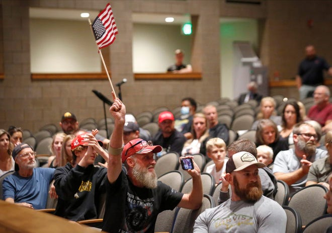Emotions ran high at the Ankeny School Board meeting at Ankeny Centennial High School in Ankeny on Tuesday, Sept. 21, 2021, as the board voted to approve a mask mandate in Ankeny schools.