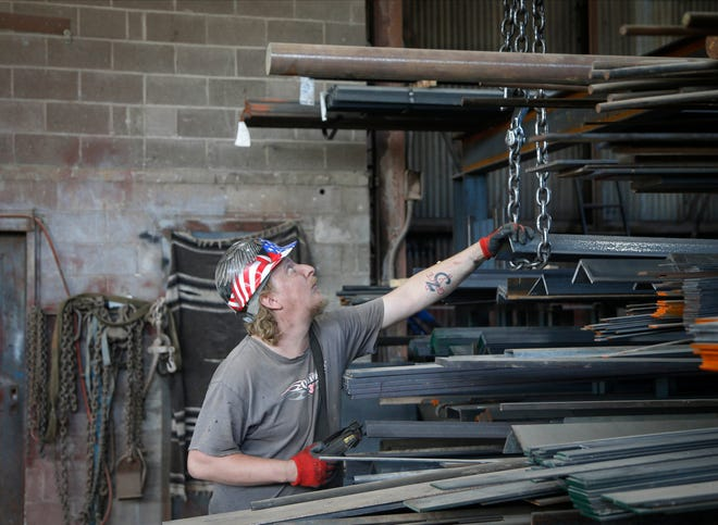 Joe Belew, a worker at Des Moines Steel, works in the shop on Wednesday, Sept. 22, 2021.