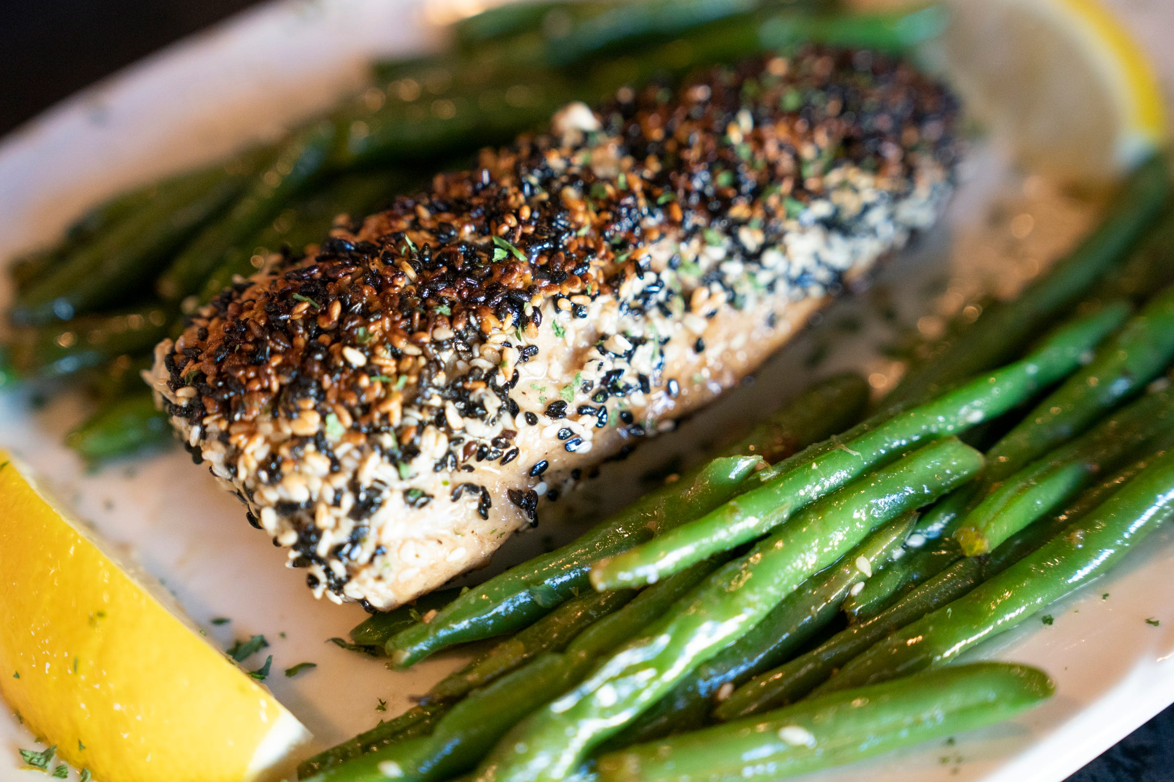 Matthew Blancke, 37, is a third-generation owner of Sindbad's Restaurant and Marina in Detroit seared this Bahamian Wahoo fish with white wine and rolled it in black and white sesame seeds served with blanched green beans on Sept. 16, 2021. The Wahoo will be a new addition to the menu.