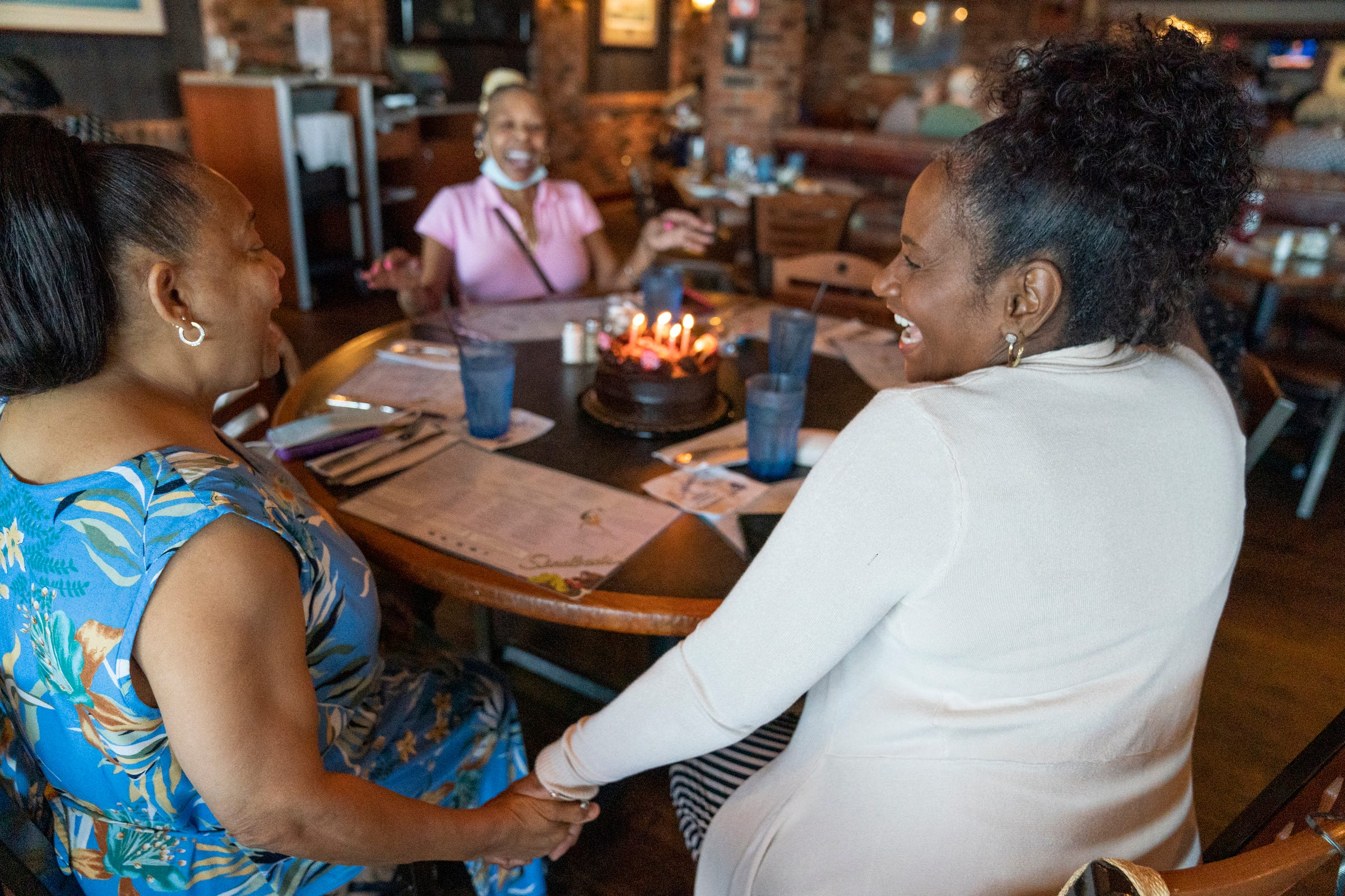 Carolyn Hood, 65, left, of Redford, celebrates a birthday with Elaine Wills, 64, of Detroit, right, at Sindbad's Restaurant and Marina in Detroit with Bonita Rodgers, 60, of Southfield, middle.