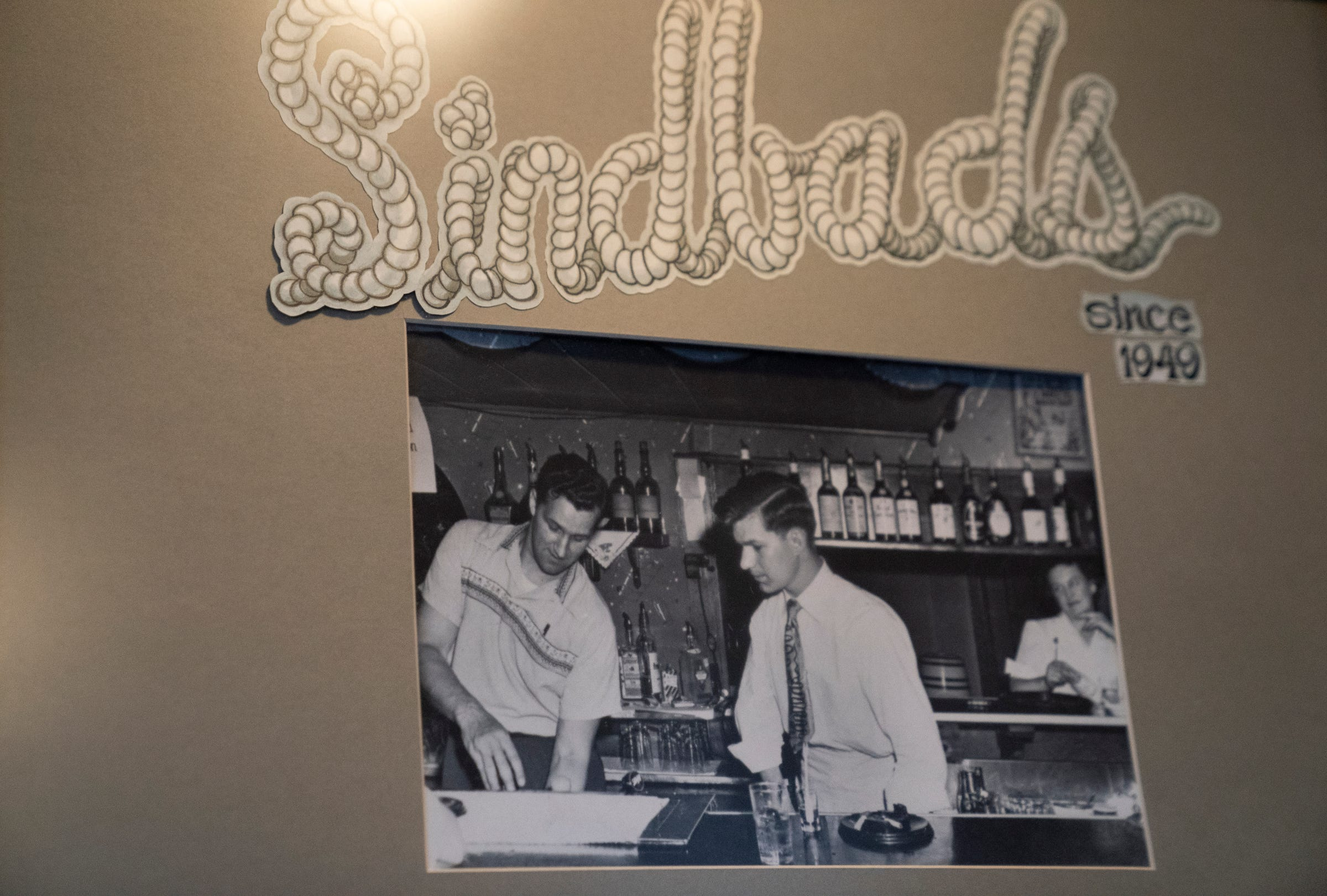 Hilaire (Van) Vanhollebeke, right and Prudent (Buster) Blancke in a photo hanging on the wall at Sindbad's. Blancke started the family-owned restaurant in 1949.