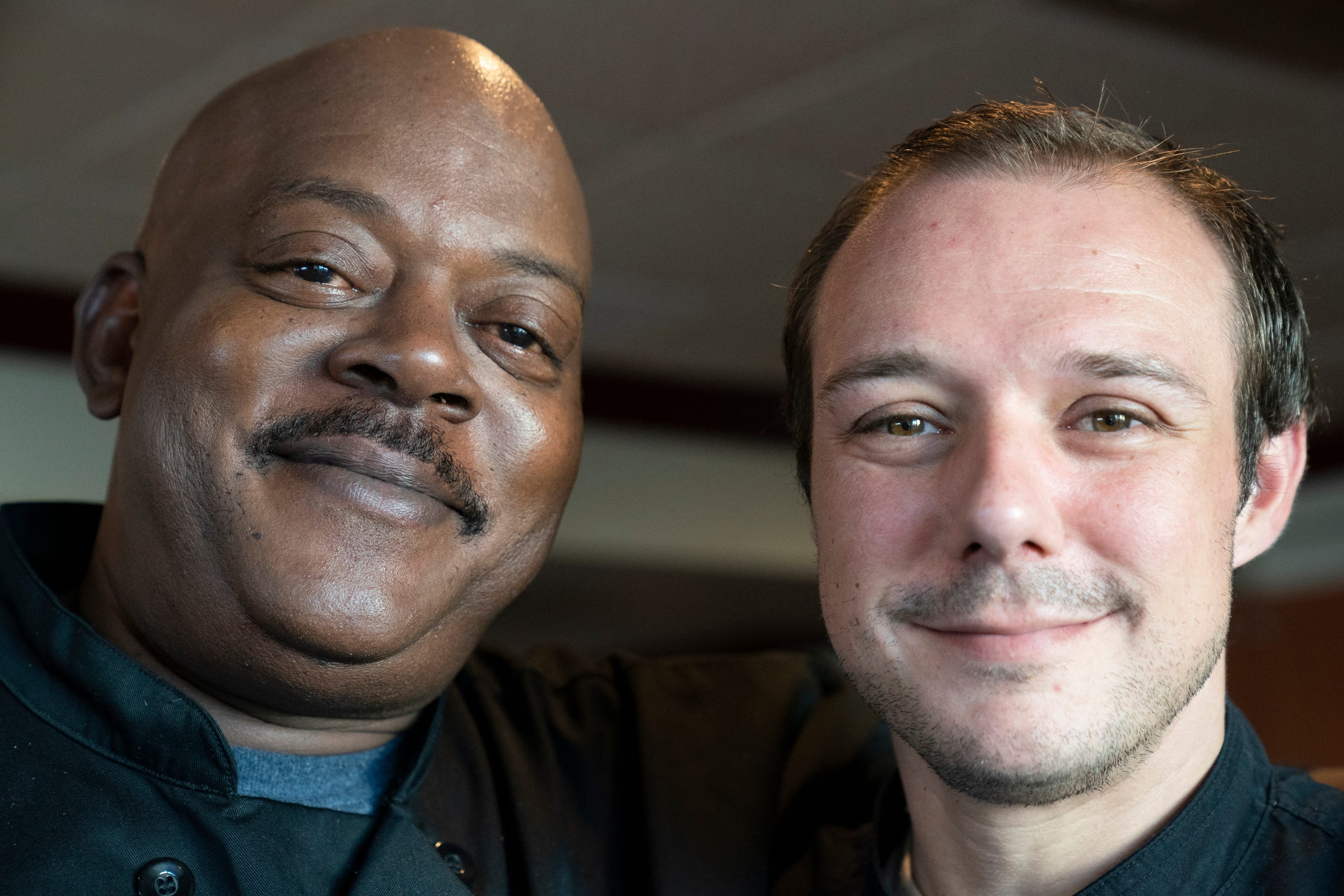 Chef Lavan Lamb, left, poses with Matthew Blancke, 37, who is a third-generation owner of Sindbad's Restaurant and Marina in Detroit. We catch up to report how the restaurant is doing through the pandemic on Sept. 16, 2021.