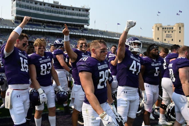 Northwestern players celebrate after an NCAA college football game against Indiana State in Evanston, Ill., Saturday, Sept. 11, 2021.