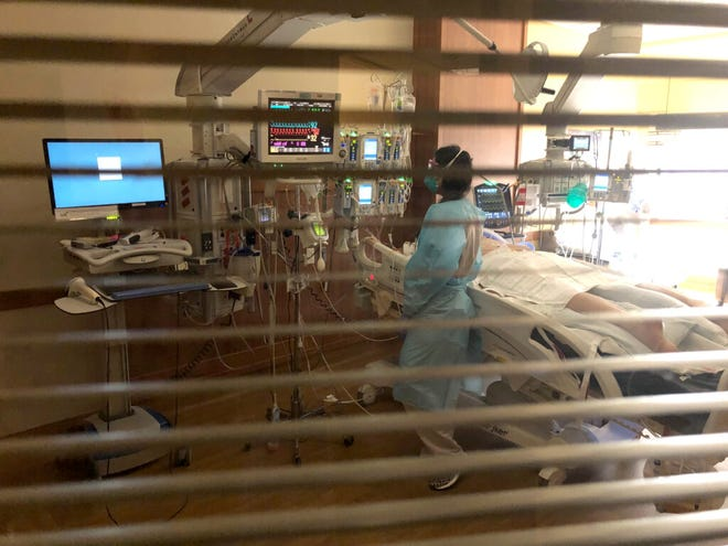 A nurse cares for a patient in the intensive care unit of Billings Clinic on Sept. 17.