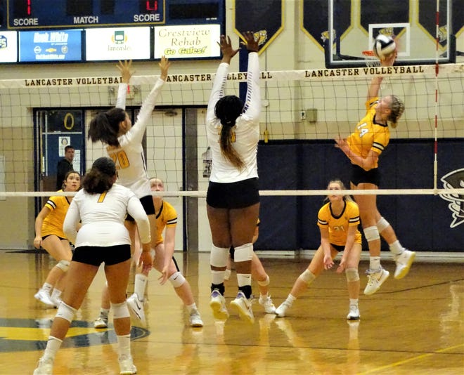 Lancaster's Ansley Baker goes up for a kill during the Lady Gales' Ohio Capital Conference-Buckeye Division game against Reynoldsburg on Tuesday.