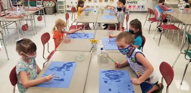 Elementary students from Marion City Schools are shown in art class.