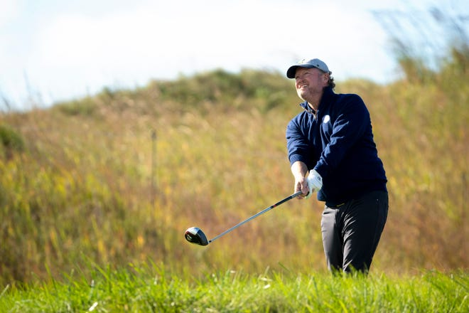 Milwaukee Bucks head coach Mike Budenholzer tees off hole No. 15 during the U.S. Junior Ryder Cup Team Exhibition at the 43rd Ryder Cup at Whistling Straits, Wednesday, Sept. 22, 2021, in Haven, Wis.