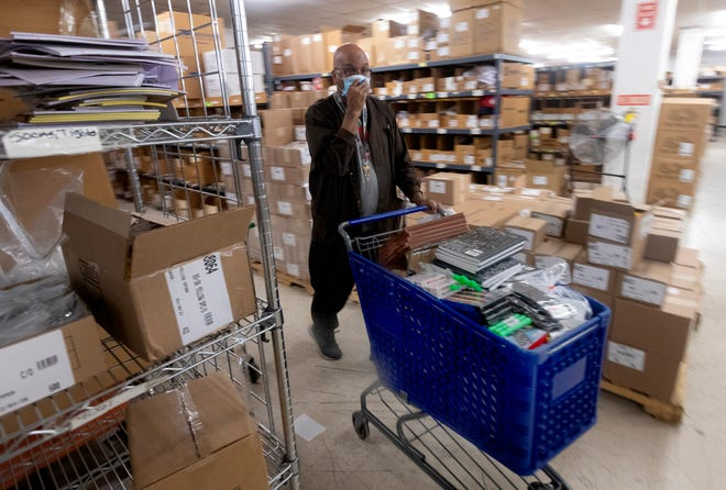 Tim Wright, a 35-year employee at the Jack L. Marcus Inc. Department Store, picks items for shipping to incarcerated offenders in Milwaukee, Wis. In addition to its department store, it is one of the companies that is currently contracted with the Dept. of Corrections where people con order select items for prison inmates.Under a new proposal, they are going to be cut out of vending to DOC, which is 30% of the company's business.