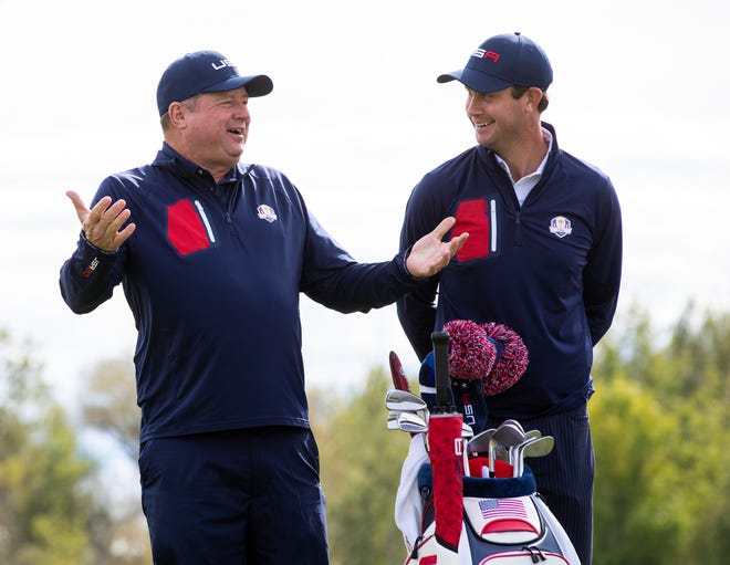 Team USA caddie Eric Larson, left, takes a photo with Harris English during the official 43rd Ryder Cup portraits at Whistling Straits.