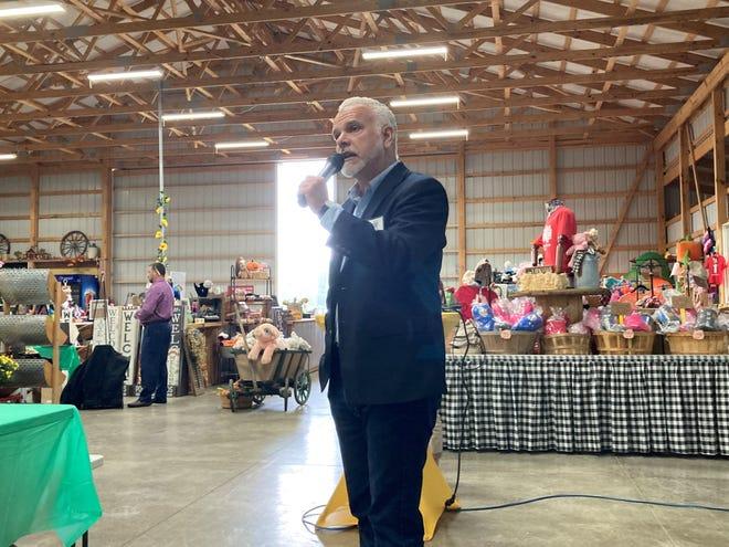 Dan Moder, executive Director of Explore Licking County, speaks at Van Buren Acres in Hebron on Sept 21.