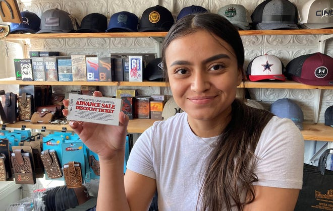 Kiara Rincon holds a Midway Carnival Day Pass now on sale at JR's Western Wear located at 119 S. Gold St. The day passes are $20 each and are good for carnival rides for a day during the Southwestern New Mexico State Fair, Oct. 6-10, in Deming.