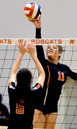 Central York's Tehya Shaw hits a return over Northeastern's Shannon Vanada in volleyball action at Northeastern Tuesday, Sept. 21, 2021. Central won in straight games. Bill Kalina photo