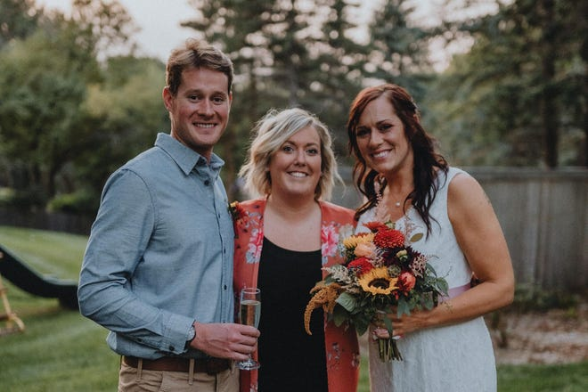 """Tiaan and Samantha Treurnicht with their """"matchmaker"""" Lindsey Tullis (middle) during their wedding reception."""