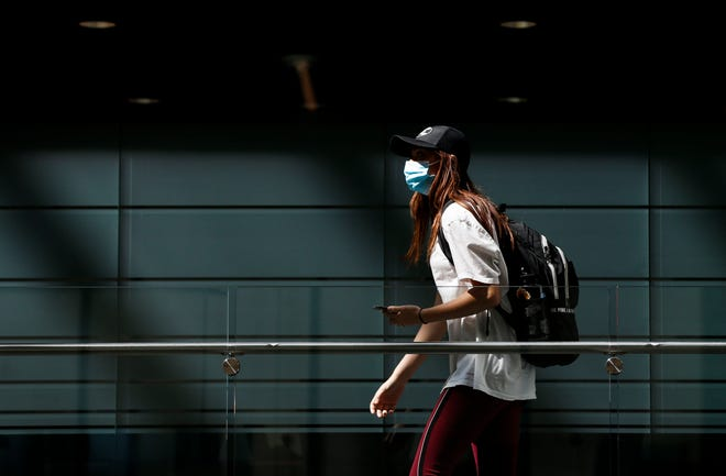 A Missouri State student walks through Glass Hall wearing a mask on Sept. 22.