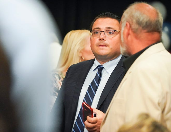 City Council District 3 candidate Anthony Bonna (center) looks at the special election results during an election watch party on Tuesday, Sept. 21, 2021, at Meating Street Seafood and Steakhouse in Port St. Lucie. Bonna will go against Travis Walker in a Dec. 7 run-off election.