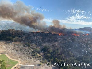 Flames from a brush fire in the Chatsworth area, east of Simi Valley, as seen from a Los Angeles County Fire Department helicopter Wednesday afternoon, Sept. 22, 2021.