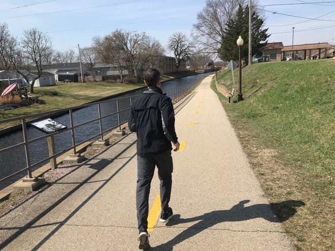 Bob Dohr runs along the Portage Canal. The Wisconsin Department of Natural Resources and several other government agencies are in the midst of rehabbing the conduit that connects the Fox and Wisconsin rivers.