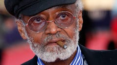 """FILE - U.S director, actor, screenwriter Melvin Van Peebles is seen during a tribute for his career at the 38th American Film Festival in Deauville, Normandy, France, Wednesday Sept. 5, 2012. Van Peebles, a Broadway playwright, musician and movie director whose work ushered in the """"blaxploitation"""" films of the 1970s, has died at age 89. His family said in a statement that Van Peebles died Tuesday night, Sept. 21, 2021, at his home. (AP Photo/Michel Spingler, File) ORG XMIT: NYPH103"""