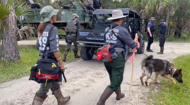 Search teams fan out at the Carlton Reserve near North Port, Fla., to search for Brian Laundrie, the boyfriend of Gabby Petito, on Sept. 22.