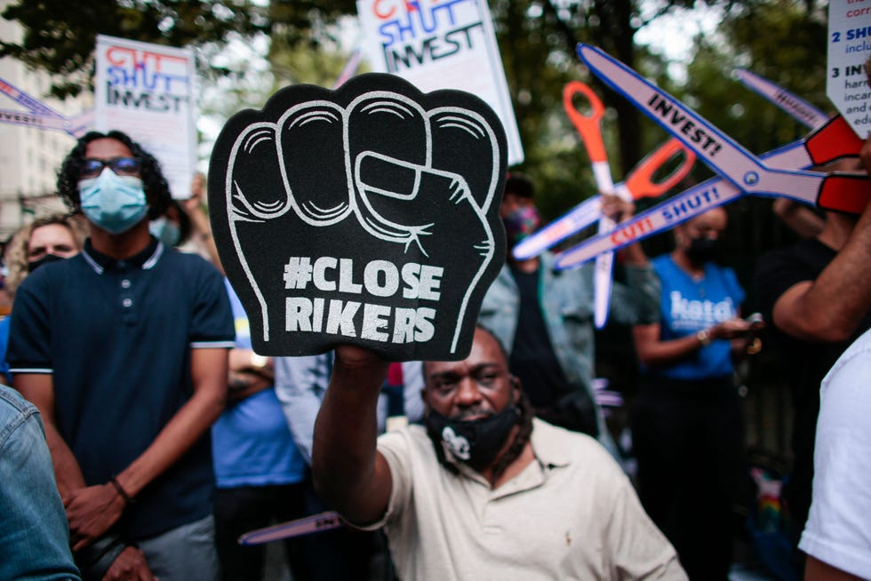 Demonstrators call for the closing of Rikers Island as they protest outside the city hall in New York, on September 22, 2021.
