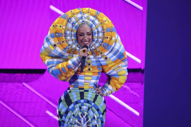 Doja Cat speaks at the MTV Video Music Awards at Barclays Center on Sept. 12 in New York.