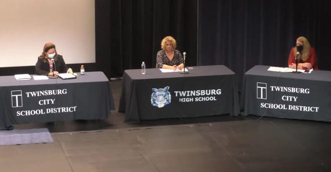 The Twinsburg Board of Education approved 3-0 a contract with Cleveland Clinic. The school board includes President Tina Davis, left, who, along with Vice President Mark Curtis and member Rob Felber, voted for it. Board members Angela DeFabio, center, and Adrienne Gordon abstained.
