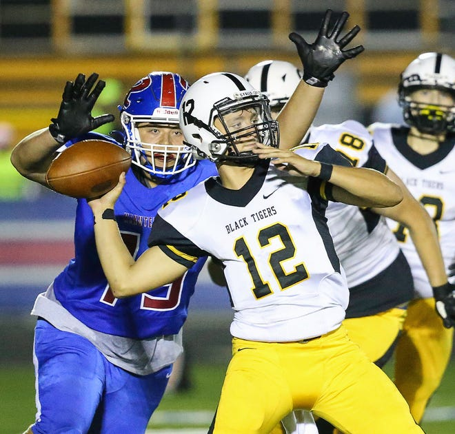 Cuyahoga Falls quarterback Jayden Hillier tosses a touchdown pass during a game at Revere earlier this season.
