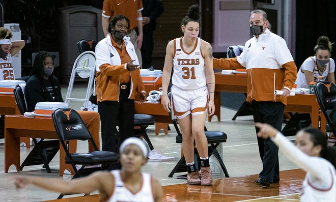 Texas coach Vic Schaefer gives instructions to Audrey Warren during a game last season. Schaefer led the Horns to a 21-10 record and the NCAA Elite Eight.