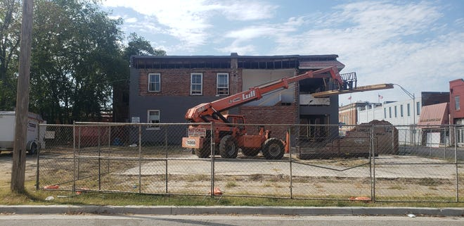 Crews work to restore the building located at 120 N. Washington St. Once complete the first floor will have space for offices and the second floor will have two loft apartments.