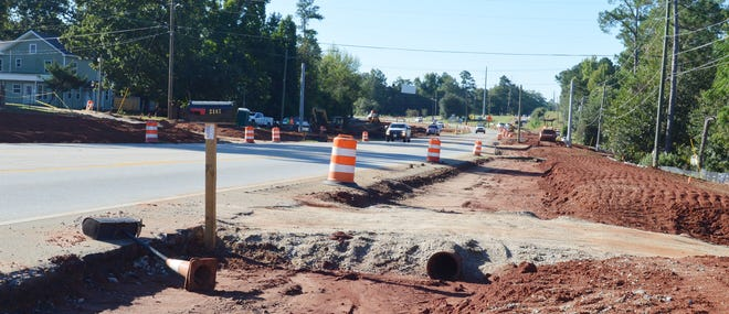 Crews work to build bed for new lanes for US Highway 1 along Louisville bypass.