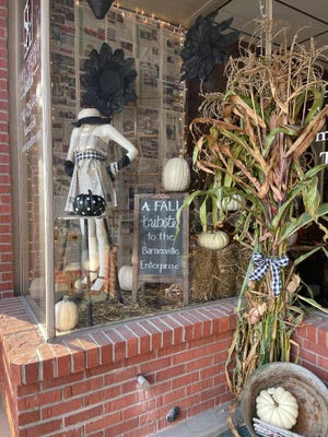 Barnesville residents Jill Hissom and Kelley Hanlon made this tribute to the end of the Barnesville Enterprise. The display is located at the Shaheen Law Group, LLC in Barnesville.The newspaper will ceasepublication on Oct. 27 after publishing a newspapersince 1866.