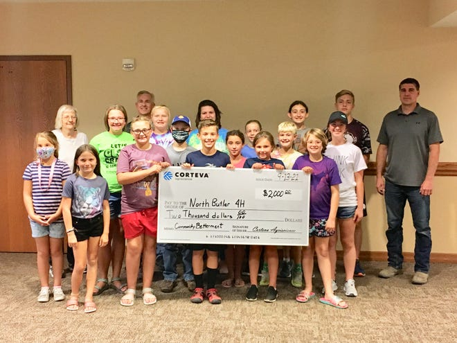 Pioneer Seed and Corteva surprises 4-H Club with check.