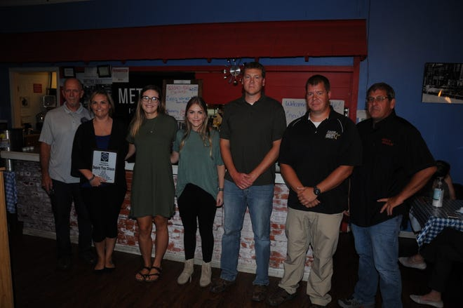Pictured from the left are: FOP Lodge 427 PresidentIke Hackett, Amanda Chisum, Kyleigh and Gracie Chisum, Sgt. Jon Webb, Sgt. Matt Watters, and Fulton County Sheriff Jeff Standard.