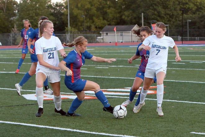 Penn Yan's # 2 Makenna Hansen and # 18 Rebecca Hays fend off the two Haverling players.